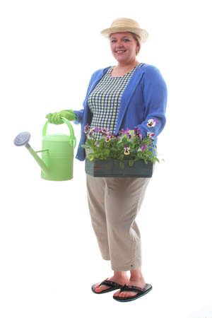 Women transplants spring flowers for mothers day gardening Stock Photo - 9492508