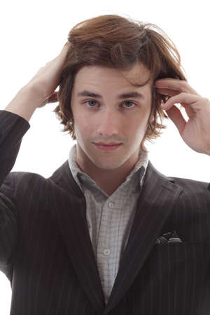Young man frets over bad hair day photo