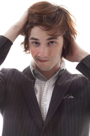 Young man frets over bad hair day Stock Photo - 9569328