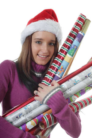 wrappings: Teenager girl holds Rolls of Christmas gift Wrapping Paper Stock Photo