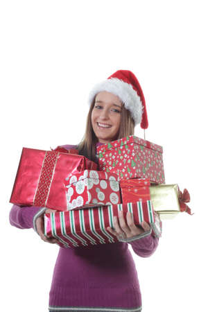 armful: Pretty Girl Carries an armful of Christmas Gifts in Wrapping Paper