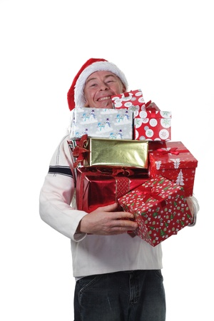 man wearing a santa hat with an armful of Christmas Gifts photo