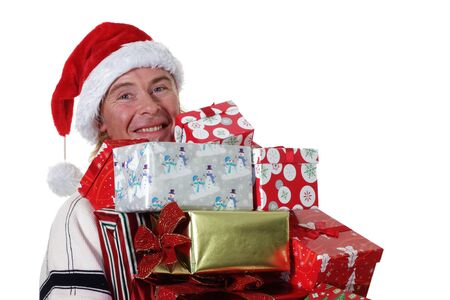 armful: man wearing a santa hat with an armful of Christmas Gifts Stock Photo