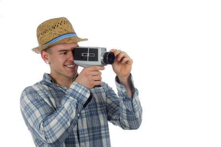 super 8: man poses with vintage super 8 video camera
