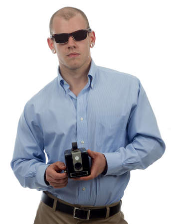 man in vintage sunglasses poses with retro camera Stock Photo - 13725779
