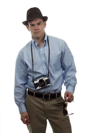 handsome man with feora and old 35mm camera photo