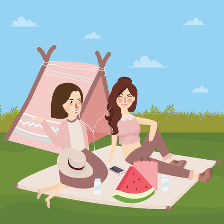 Teenagers sitting and having picnic.