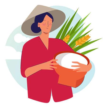 Woman farmer holding basket wearing cap in rice padi field harvesting. Traditional farming organic nature