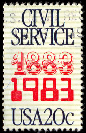 united states postal service: USA - CIRCA 1983: A stamp printed in United States of America commemorates the 100th anniversary of the Civil Service, circa 1983