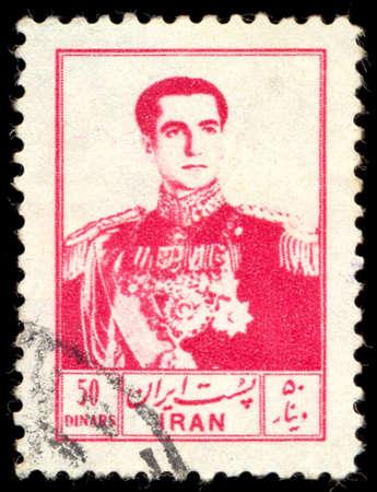 mohammad: IRAN - CIRCA 1954: A stamp printed in Iran shows portrait of Mohammad Reza Shah Pahlavi (1919-1980), circa 1954