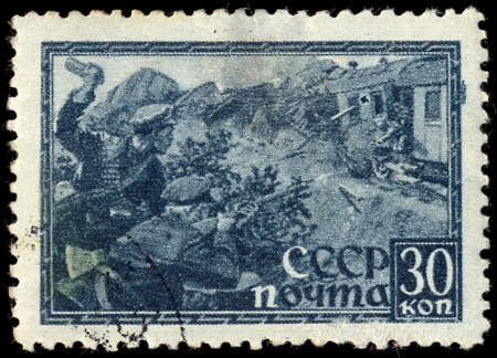 SOVIET UNION - CIRCA 1943: A stamp printed by the Soviet Union Post is entitled shows Russian soldiers attacking a fascist train, circa 1943