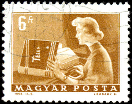 HUNGARY - CIRCA 1964: a stamp printed by Hungary shows Telex operator. Series Post and Reporting. Circa 1964. Editorial