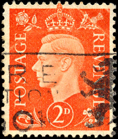 dominions: UK - CIRCA 1950: A stamp printed in UK shows image of the George VI (Albert Frederick Arthur George) was King of the United Kingdom and the Dominions of the British Commonwealth, circa 1950.