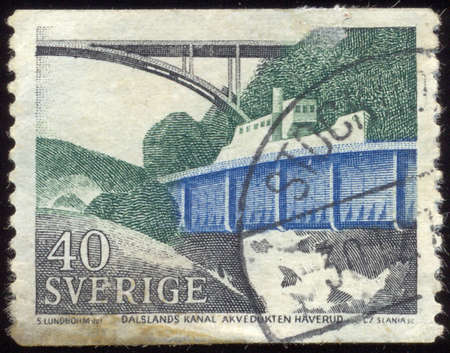 commemorate: SWEDEN - CIRCA 1968: a stamp printed in the Sweden shows Dalsland Canal, Swedish Channel which Connect Lake Vanern with Southwestern Varmland Lake Districts, circa 1968