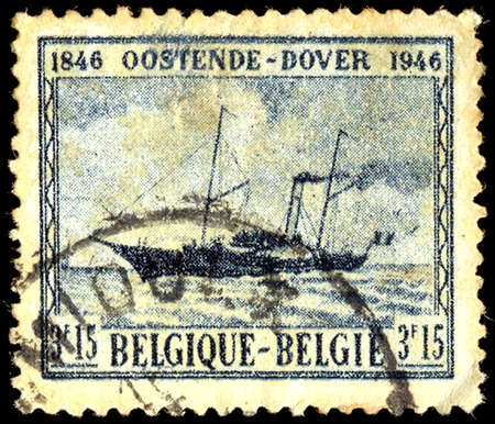 centenary: BELGIUM - CIRCA 1946: A stamp printed in Belgium shows Marie Henriette - paddle-steamer, Ostend - Dover Mail-boat Service Centenary, circa 1946 Editorial