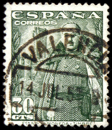 SPAIN - CIRCA 1948: A stamp printed in Spain shows General Franco and Castillo de la Mota, circa 1948.