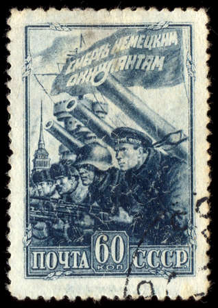 german fascist: USSR - CIRCA 1942: A stamp printed in the USSR shows Defense of Leningrad in ww2 war, circa 1942. Editorial