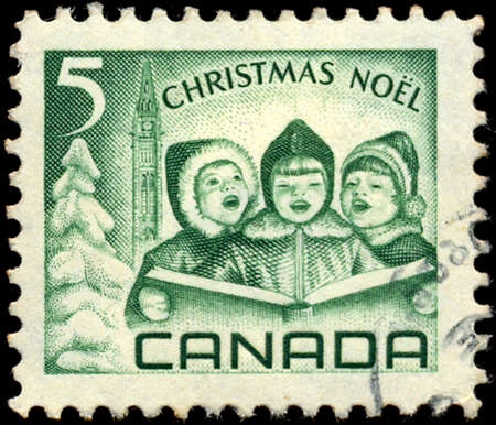 canada stamp: CANADA - CIRCA 1967: a stamp printed in the Canada shows Singing Children and Peace Tower, Ottawa, Christmas, circa 1967 Editorial