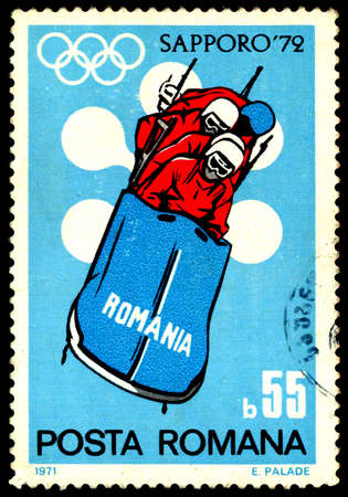 olympiad: ROMANIA - CIRCA 1972: A stamp from Romania shows image of a bobsleigh team and commemorates the 1972 Sapporo Winter Olympics, circa 1972 Editorial