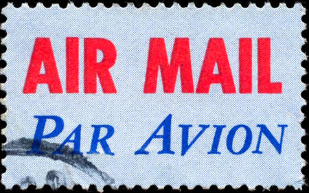 par avion: USA-CIRCA 1973: A United States Airmail postage sticker, showing red AIR MAIL with blue PAR AVION, denoting mail is for international airmail and not USA domestic airmail, circa 1973. Editorial