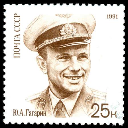 gagarin: Russia - CIRCA 1991: A stamp printed in USSR shows Yuri A. Gagarin (1934-1968), cosmonaut, wearing hat, circa 1991