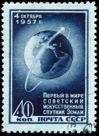 circling: USSR - CIRCA 1957: stamp printed by Russia, shows Sputnik 1 Circling Globe, circa 1957 Editorial