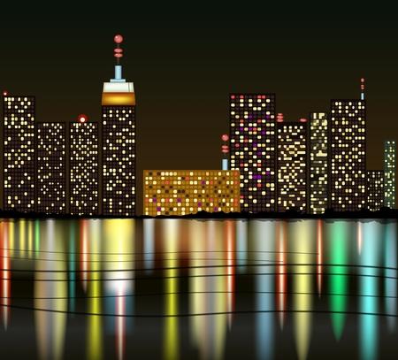Ville la nuit avec la réflexion dans l'eau