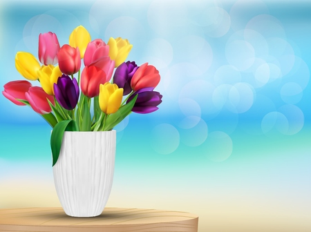 Tulip flowers in rainbow colours in a white glass on the beach photo