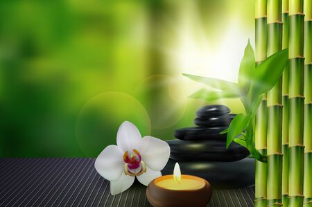 Stone, flower, wax and bamboo on the table background