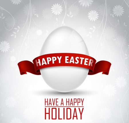 Easter egg with a red ribbon on white background