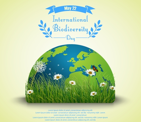 Green grass and flowers with earth for International biodiversity day background