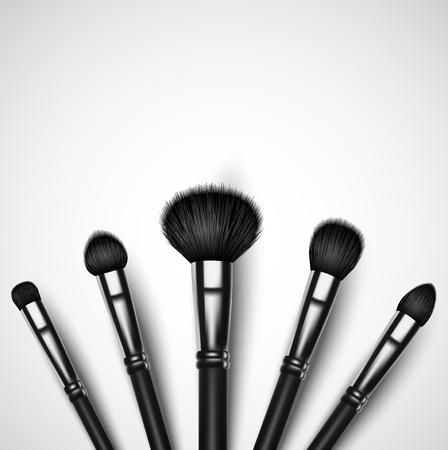 Set of makeup brushes on white background