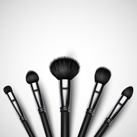 makeup brushes: Set of makeup brushes on white background