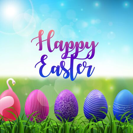 Easter background with colored easter eggs in the grass on sunny sky background