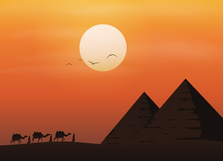 Caravan with camels in desert with pyramids on beautiful sunset background