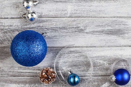 blue and silvery christmas balls on a wooden background