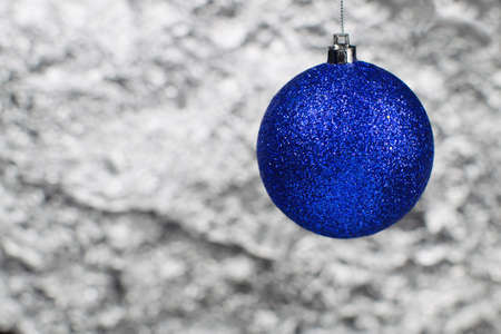 one blue christmas ball on a silvery background Stock Photo
