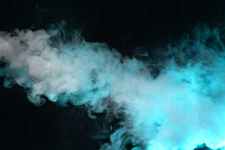 cloud of vapor. dark blue background. nobody