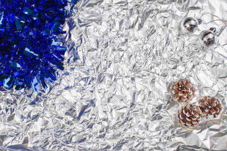 silvery christmas balls on a silvery background