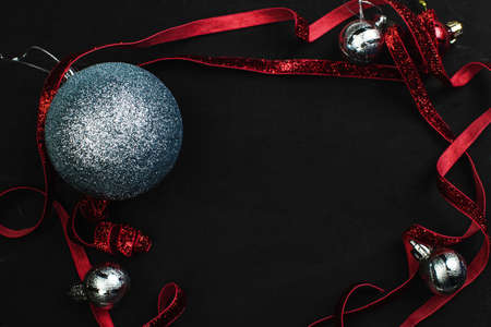 red and silvery christmas balls on a black background