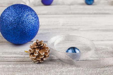 blue and silvery christmas balls on a wooden background Reklamní fotografie - 92299815