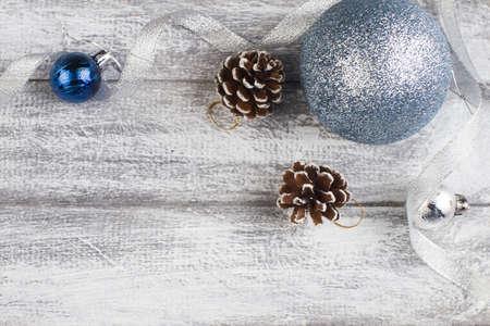blue and silvery christmas balls on a wooden background Reklamní fotografie - 92872205