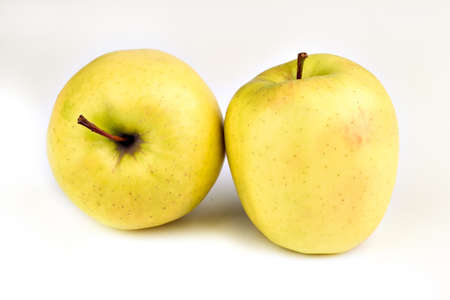 Fresh ripe juicy yellow apples on a white background