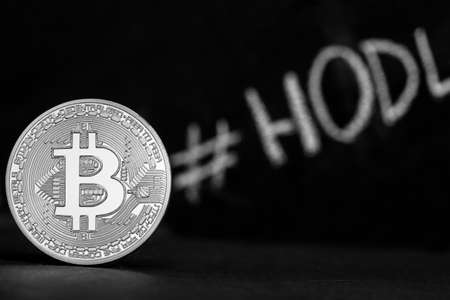 coin bitcoin on a black background stands on the edge Reklamní fotografie