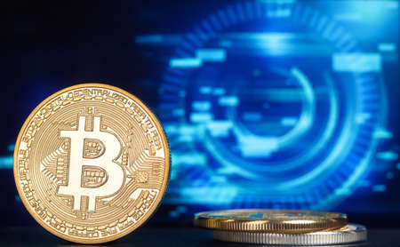 coin bitcoin on a multicolored blurred background on the table