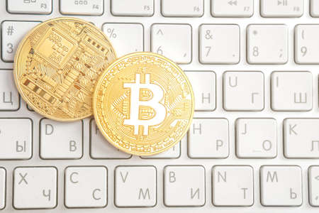 coin bitcoin on the laptop keyboard on the table