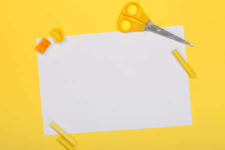 paints, scissors, white sheet of paper and pastel on a bright yellow background  Reklamní fotografie