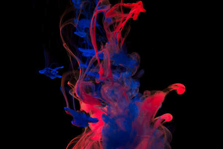 Color paint drops in water. Ink swirling underwater. Cloud of silky ink collision on black background. Colorful abstract smoke explosion animation. Close up camera view. Reklamní fotografie