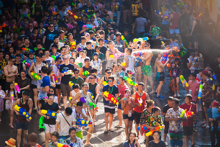 BANGKOK, THAILAND - April 13: Famous Songkran Festival in Silom on April 13, 2018. One of the most popular water fight places during Songkran in Bangkok, Thailand.