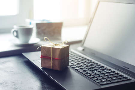 views of gift box and laptop, the concept of e-shopping Stock Photo - 67738497